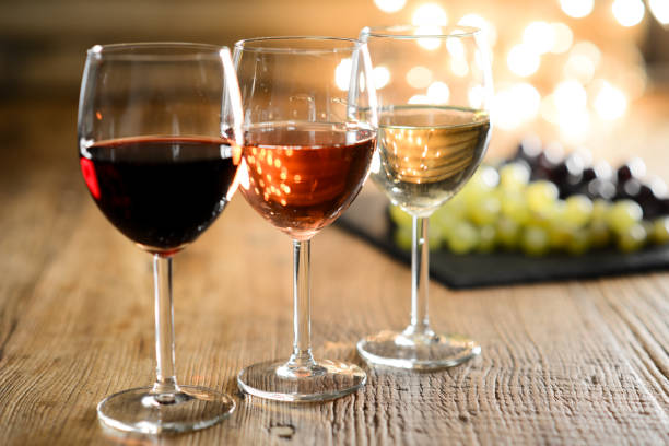Three glass of white red and rose wine with dim light in wooden a picture id1011813752?b=1&k=6&m=1011813752&s=612x612&w=0&h=fzwpdx32kcvhfcbfmtcwwrz9nrvrtdswve9ontolxba=