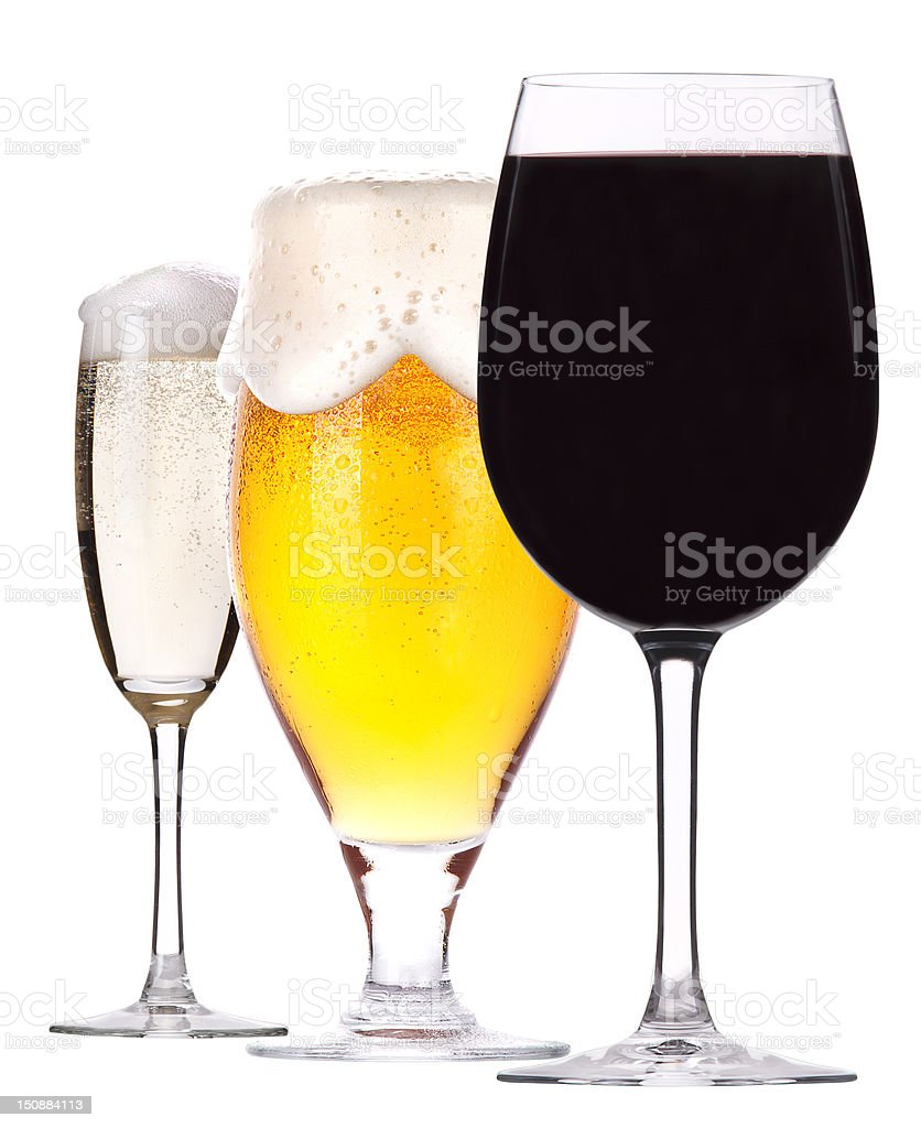 Three glasses of champagne, beer and wine stock photo