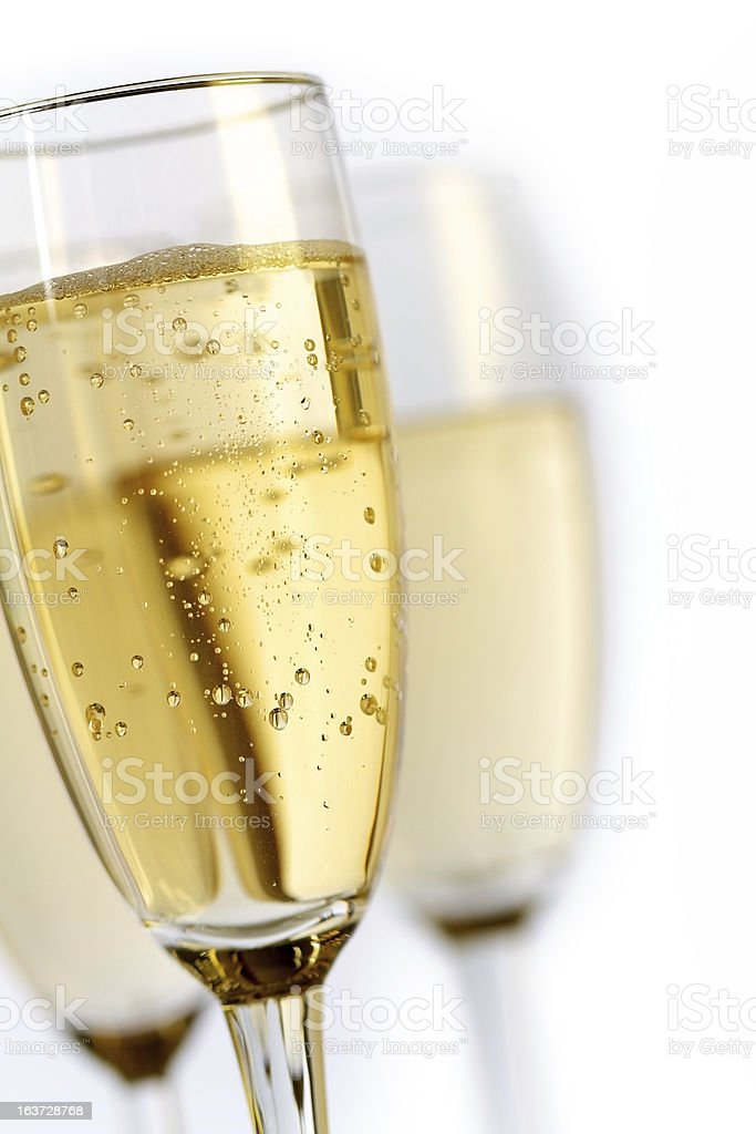 Three glasses of champagne on a white background stock photo