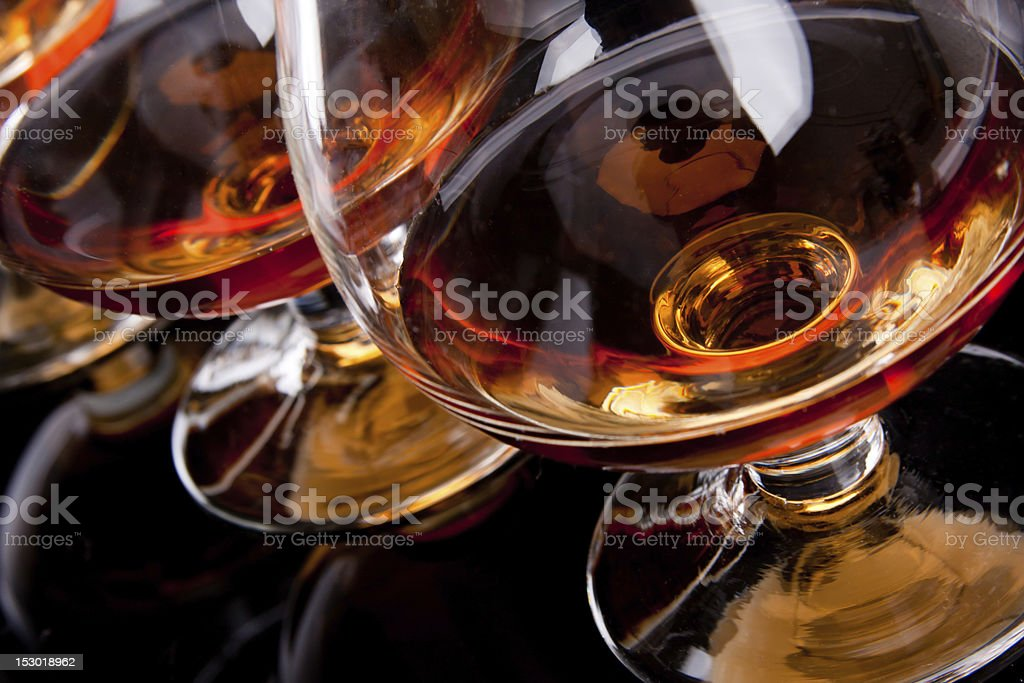 Three glasses of cognac stock photo