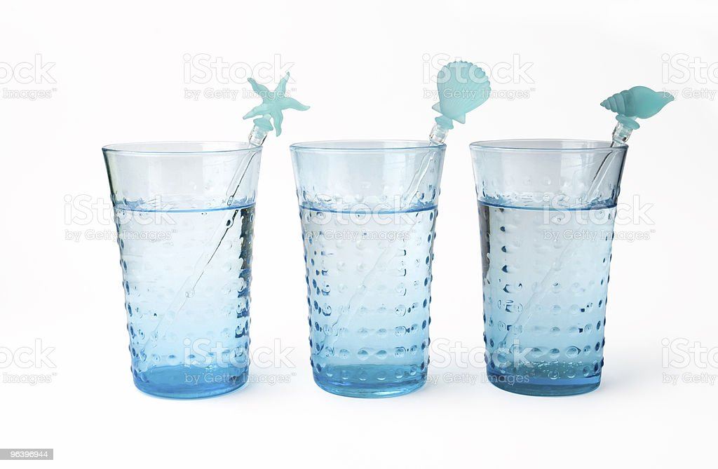 Three glasses of mineral water with straw royalty-free stock photo