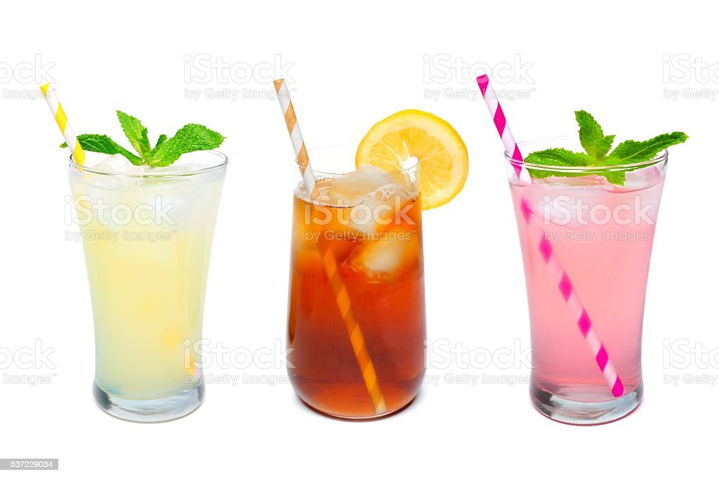 Three glasses of summer drinks with straws over white stock photo