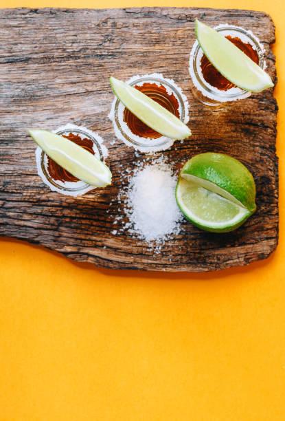 tres copas de tequila - mezcal fotografías e imágenes de stock