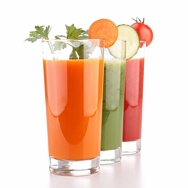 Three glasses of vegetable juice on a white background vegetable juice vegetable juice stock pictures, royalty-free photos & images