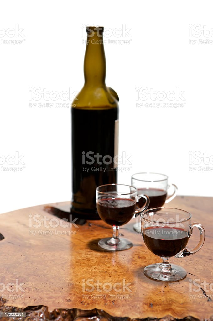 Three glasses of vintage port on wooden table with bottle royalty-free stock photo