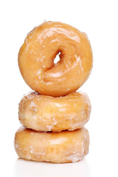trois glaçage donuts - glaçage photos et images de collection