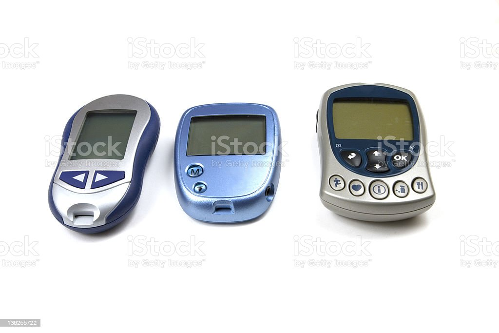 Three Glucose Testers of Various Brands royalty-free stock photo
