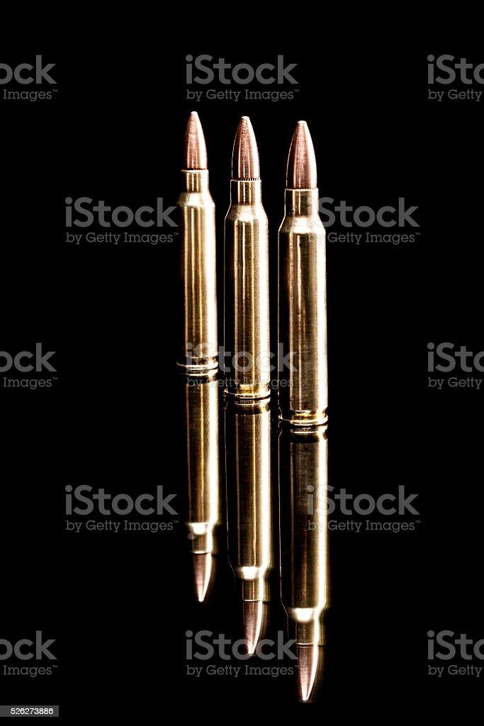 Three Gold Bullets stock photo