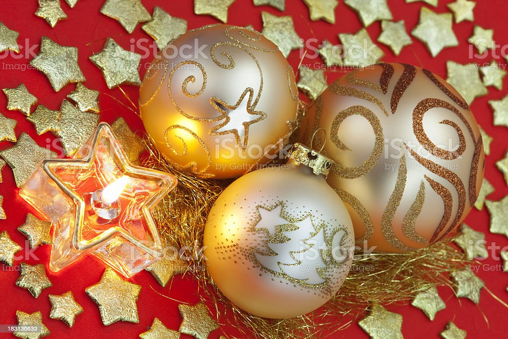 Three Gold Christmas Baubles with Candle & Stars royalty-free stock photo