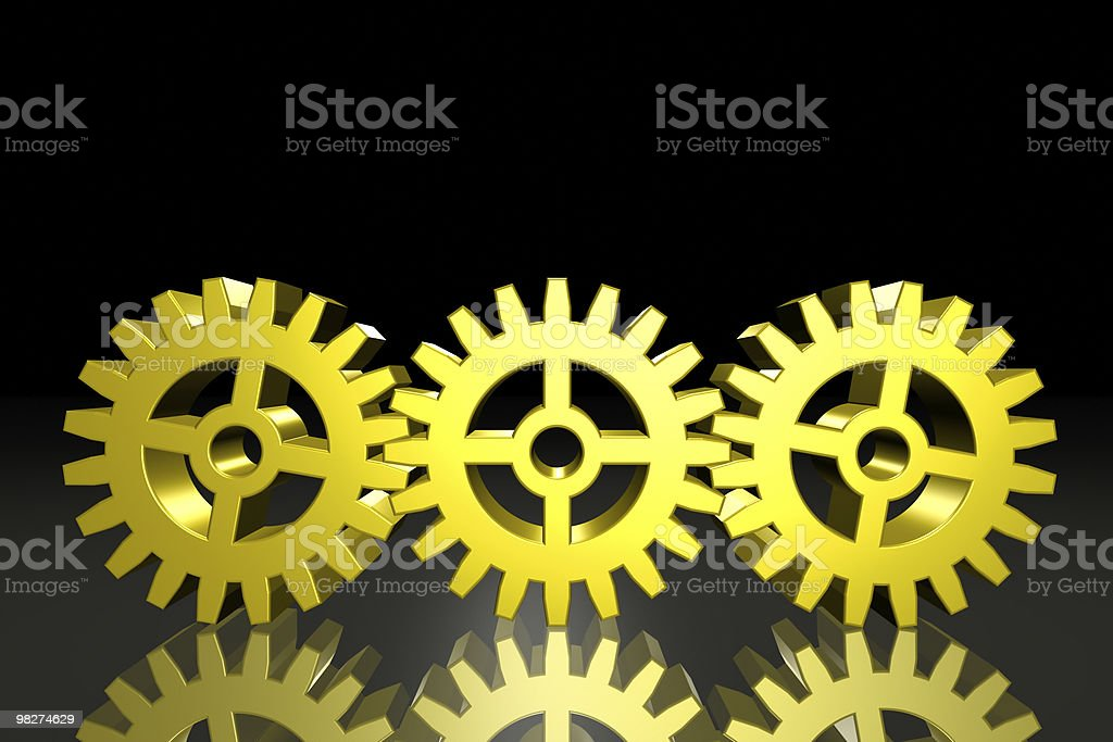 Three Gold Gears royalty-free stock photo