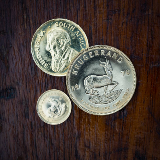 Three Gold Krugerrand Coins stock photo