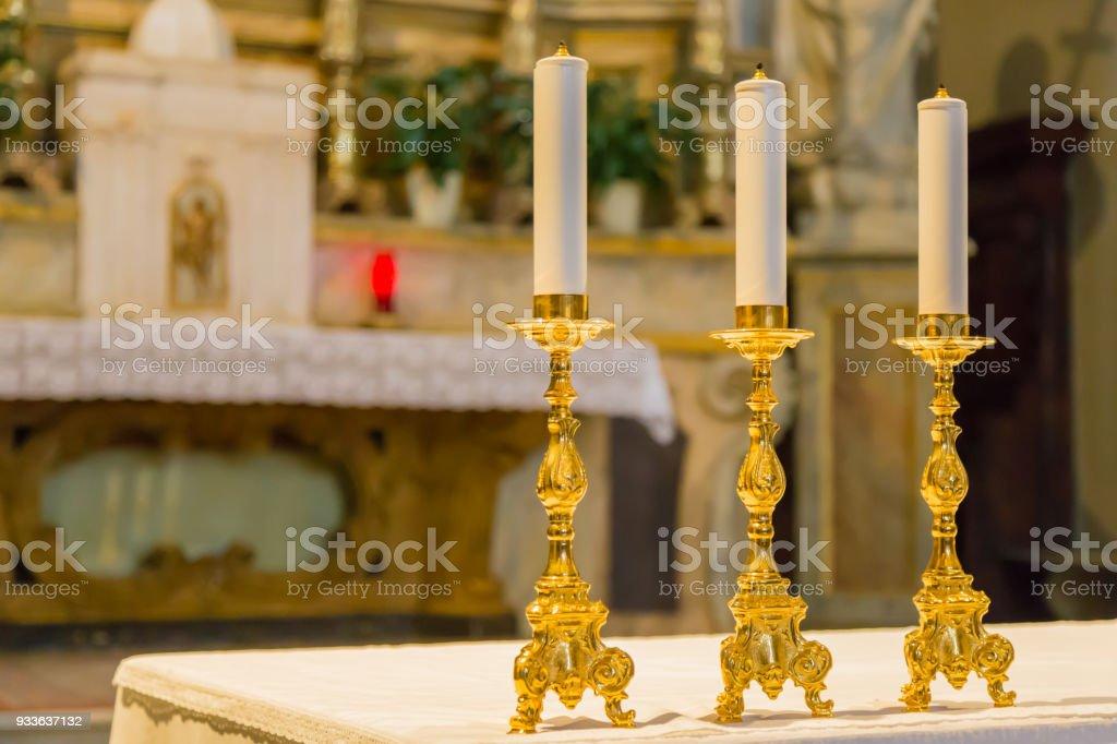 Three golden candelabra. stock photo