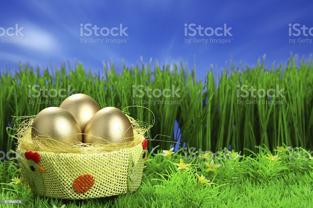 Three golden easter eggs royalty-free stock photo