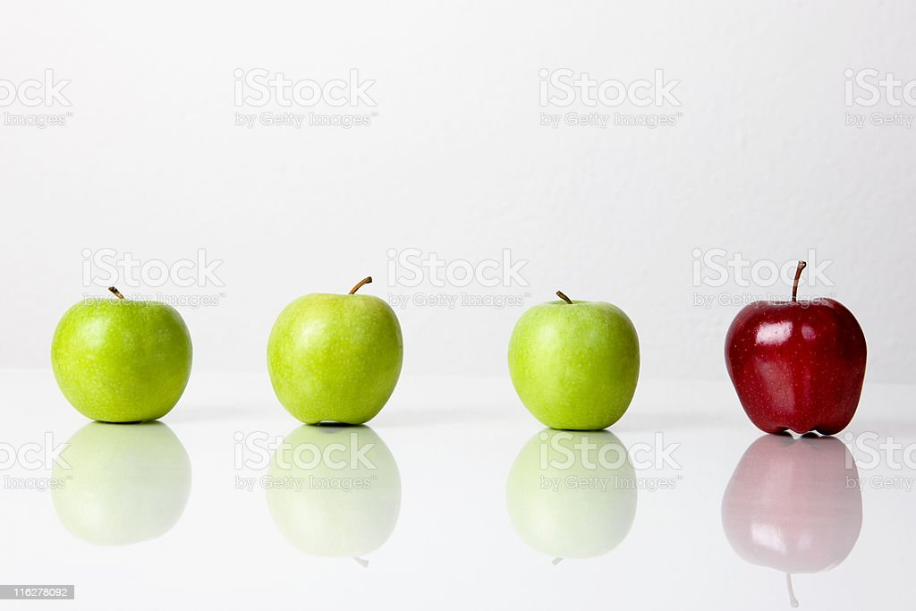 Three green apples and one red on white royalty-free stock photo
