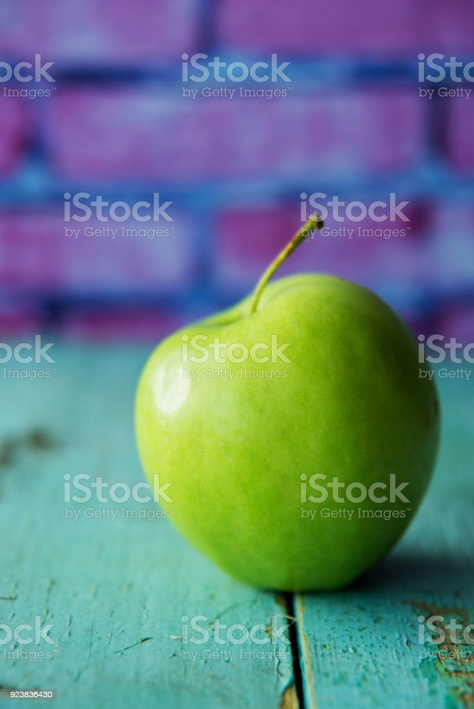 Three green healthy fresh apples against white brick wall background with scandinavian flower ficus beside. Country side farm fruit production. Vitamin A C. regeneration heart cells. Healthy lifestyle stock photo