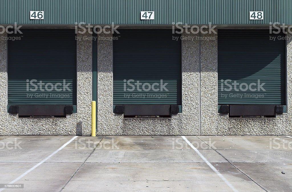 Three green warehouse loading bays royalty-free stock photo