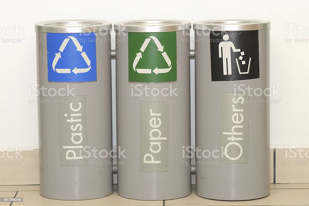 Three grey recycling bins are standing in a line  royalty-free stock photo