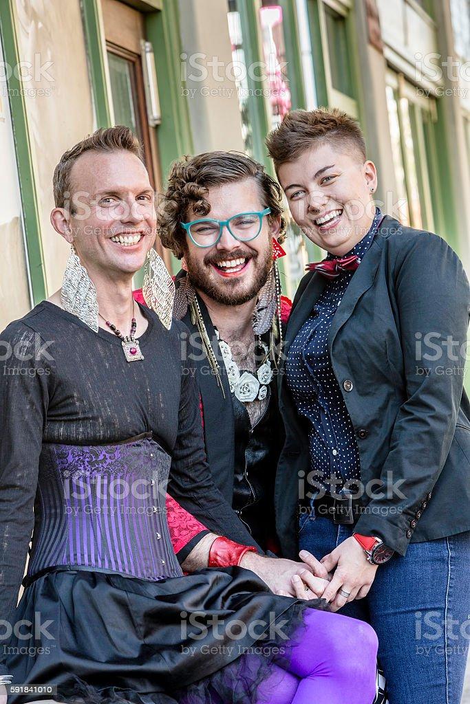 Three Grinning Gender Fluid Friends stock photo