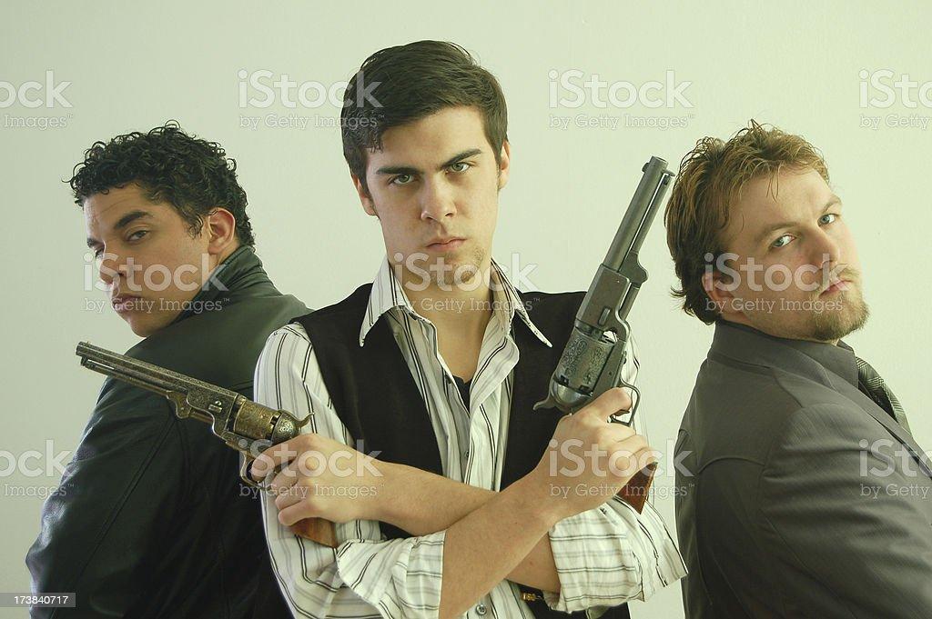Three Gunmen stock photo