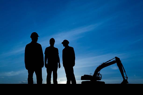 Drei Männer in einer Baustelle – Foto