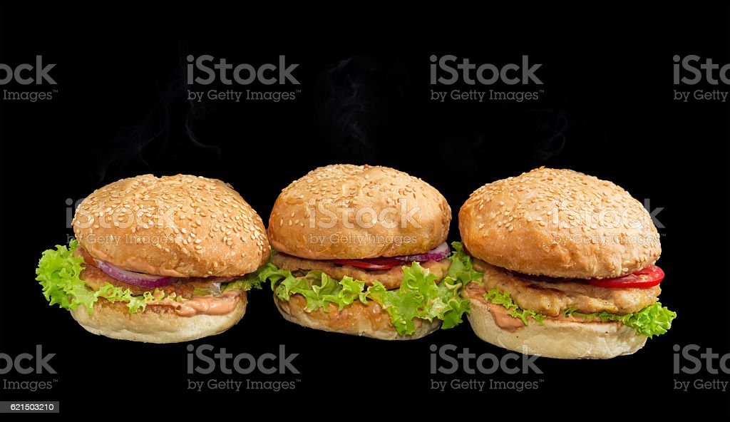 Three hamburgers on a dark background Lizenzfreies stock-foto