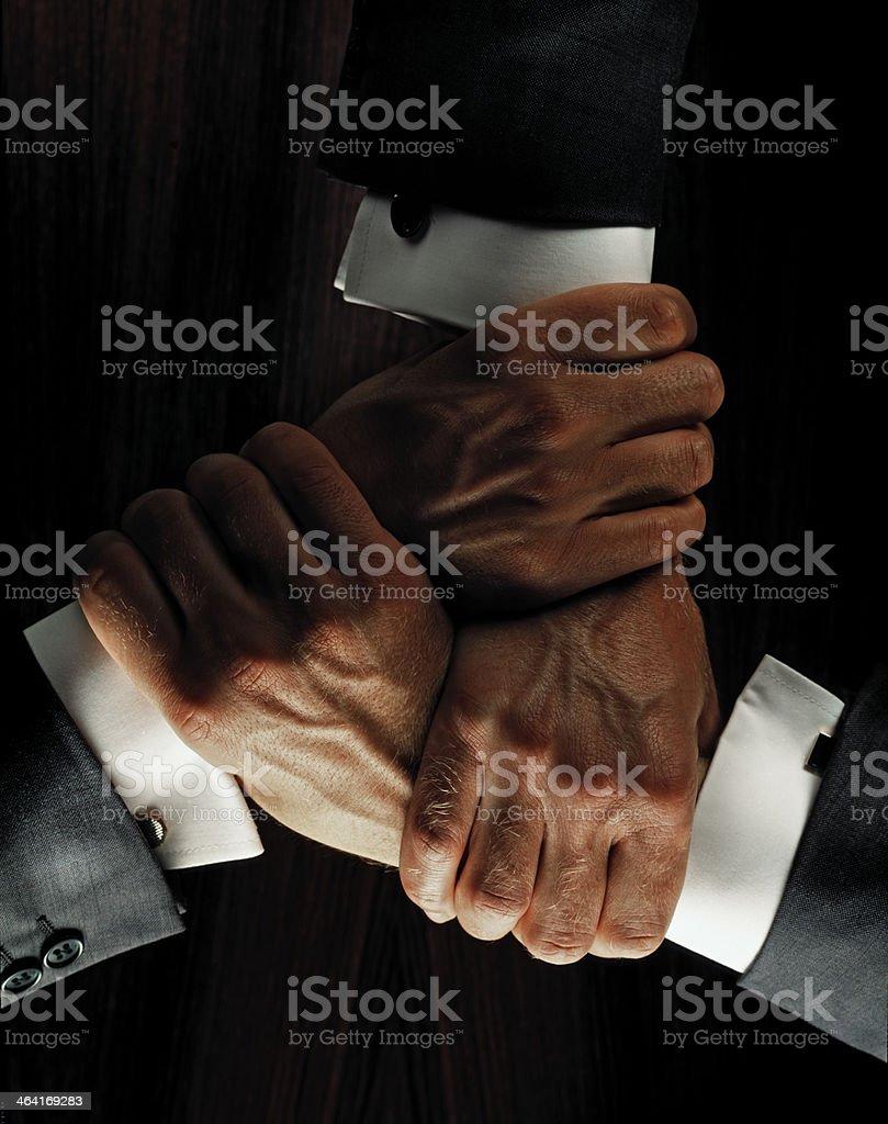 Three hands holding stock photo