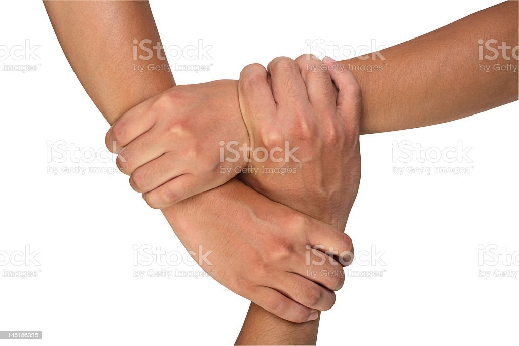 Three hands holding to form a triangle against white stock photo