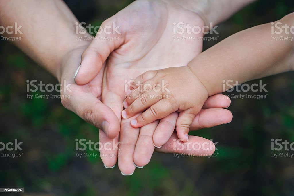 Three hands of the same family. stock photo