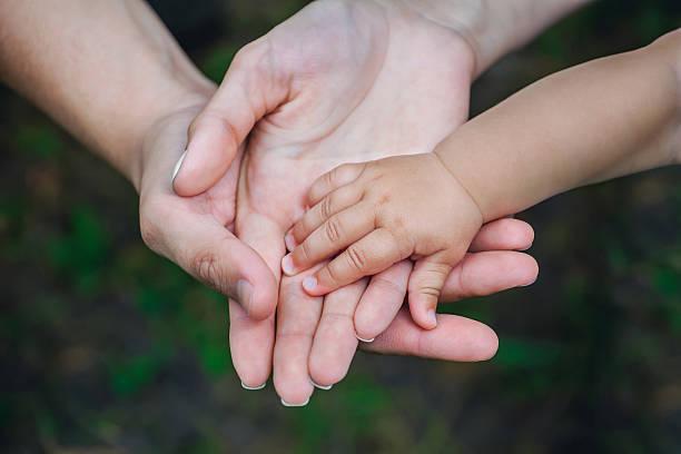 three hands of the same family. - mano donna dita unite foto e immagini stock