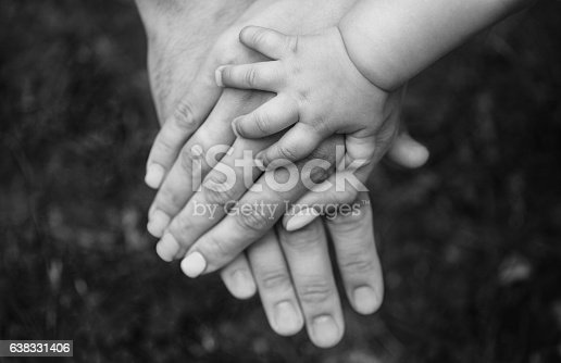 istock Three hands of the same family. 638331406