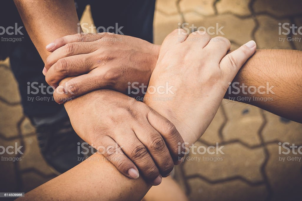 Three hands were a collaboration concept of teamwork stock photo