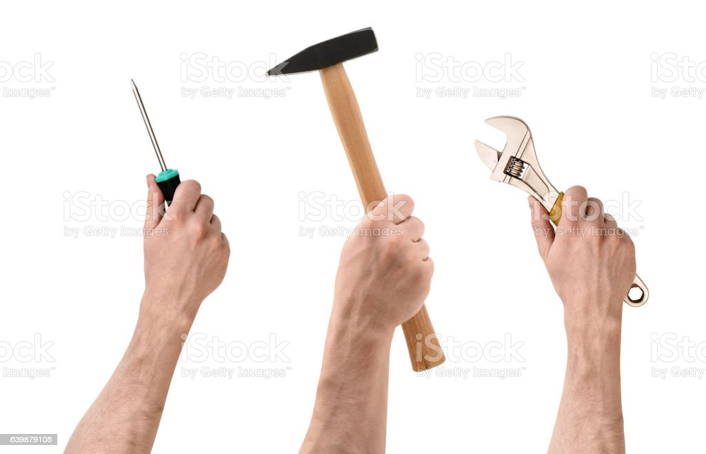 Three hands with screwdriver, hammer, and wrench on white background stock photo