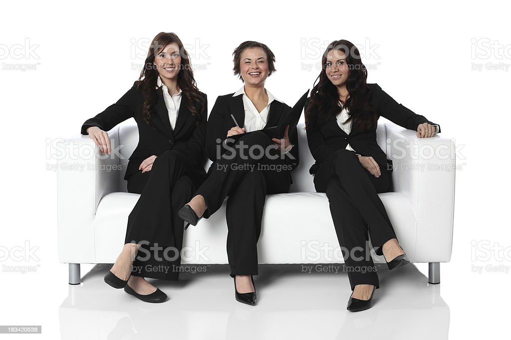 Three happy businesswomen sitting on a couch royalty-free stock photo