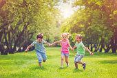 Happy children running together in park