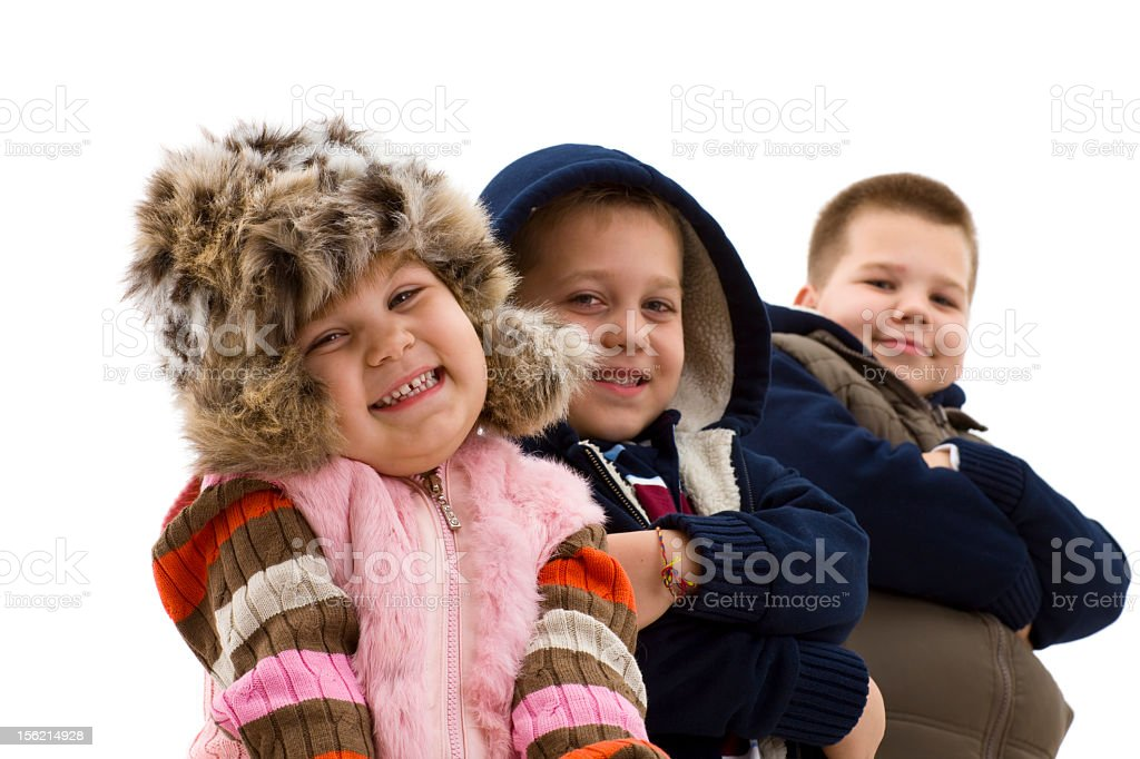 Three happy children standing side-by-side stock photo