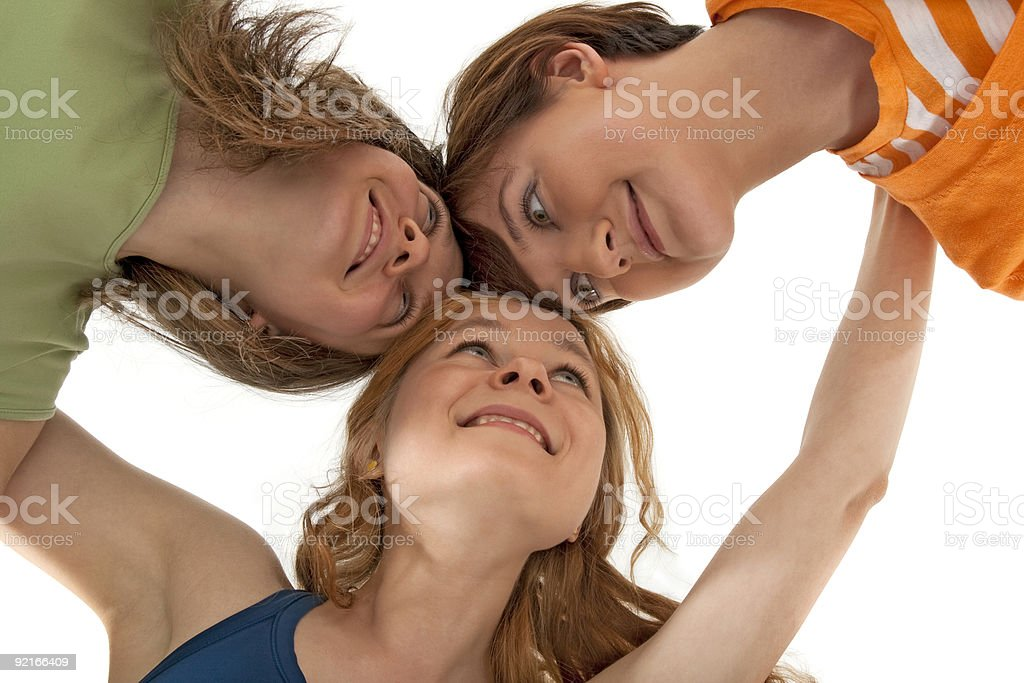 Three happy friends looking at each other royalty-free stock photo