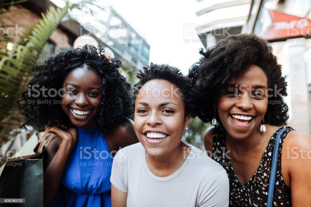 Three happy friends stock photo