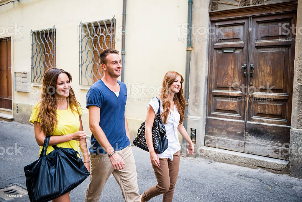 Three happy friends walking in the city royalty-free stock photo