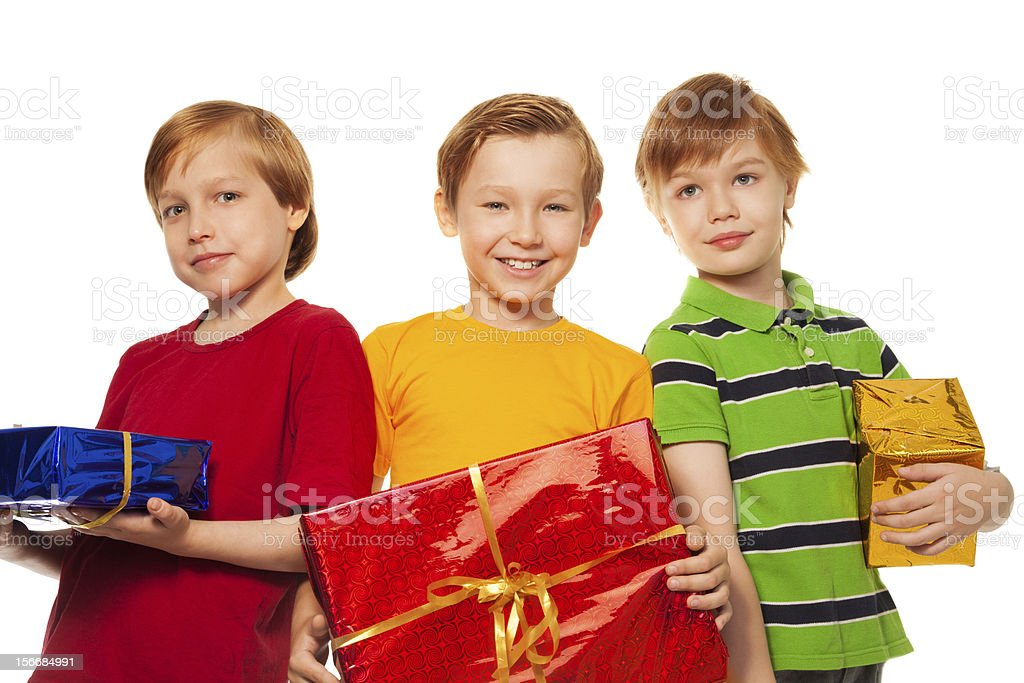three happy friends with presents royalty-free stock photo