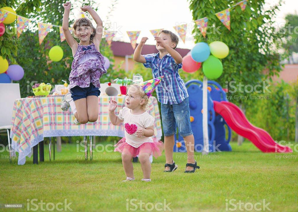 Three happy kids dancing royalty-free stock photo