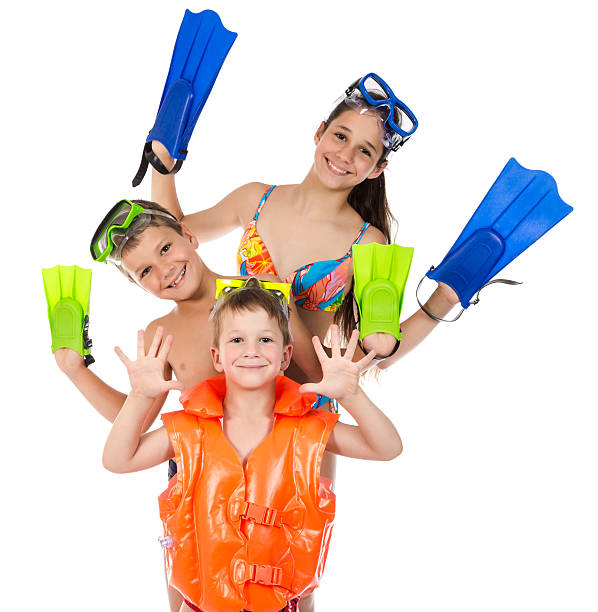 Three happy kids in diving mask standing together stock photo