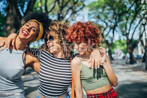 700702502istockphoto Three happy ladies in city 1194471890