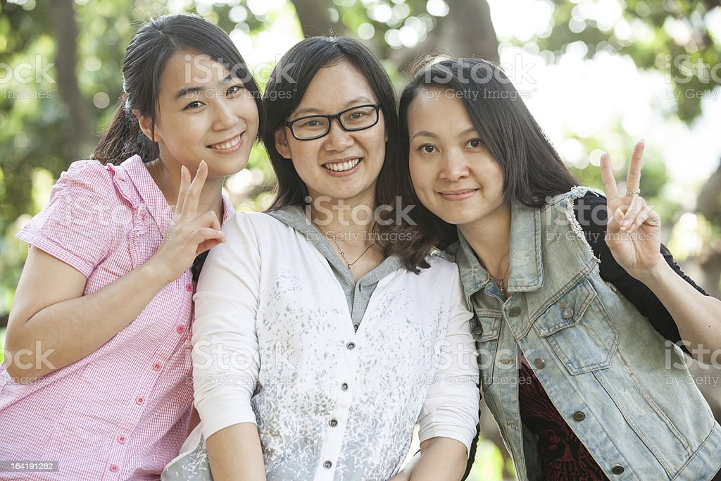 Three happy young Asian woman smiling royalty-free stock photo