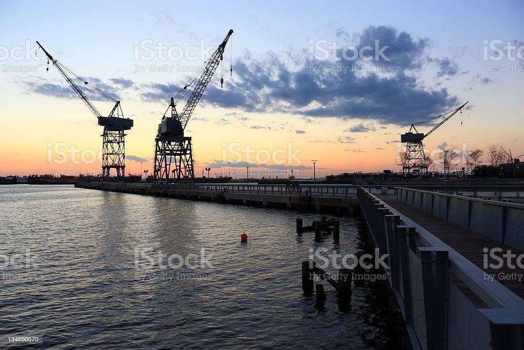 Three Harbor Cranes stock photo