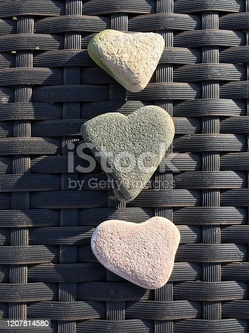 450754061 istock photo Three heart-shaped rocks 1207814580