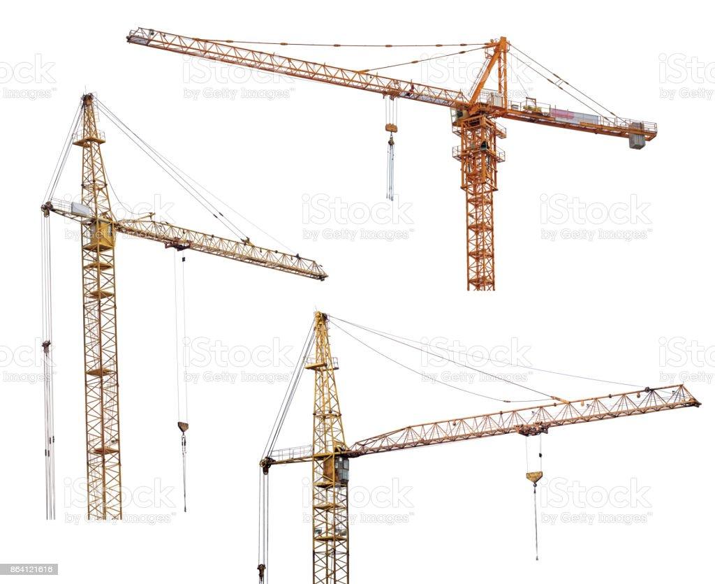 three heavy dark cranes on white royalty-free stock photo