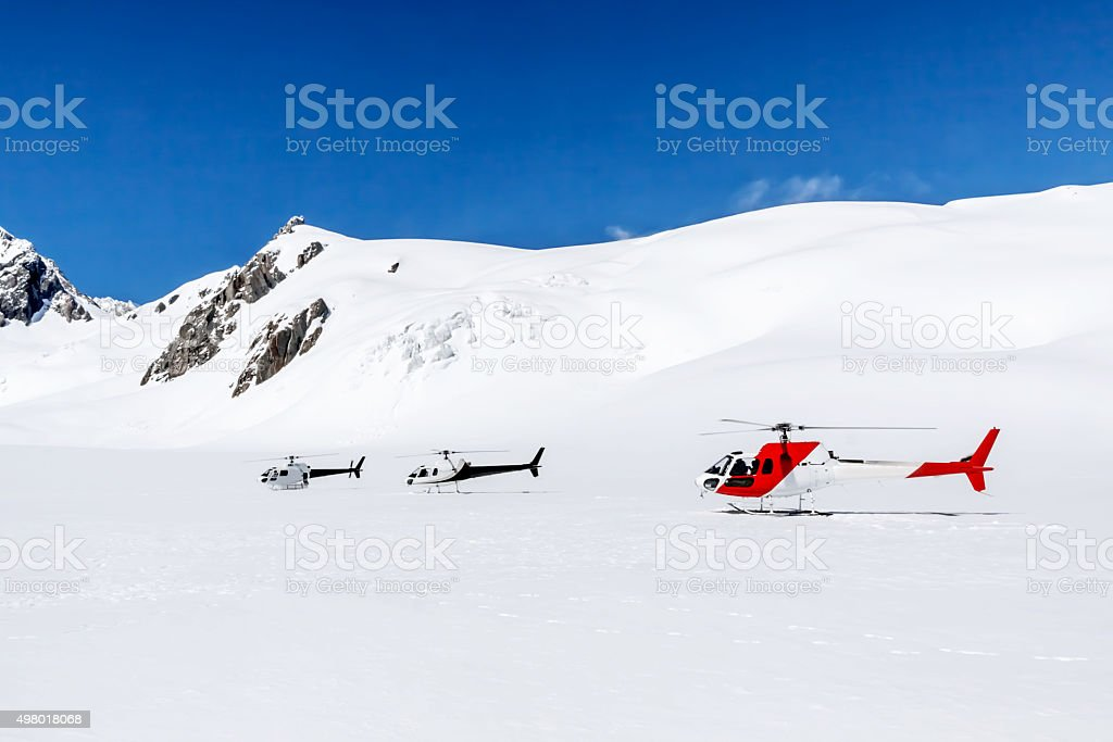 Three Helicopters On A Mountain stock photo