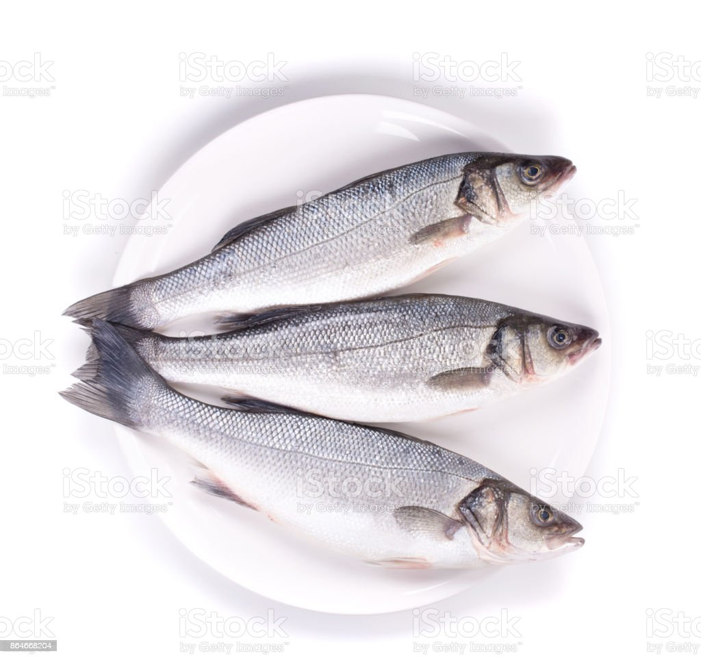 Three herrings on a plate. stock photo