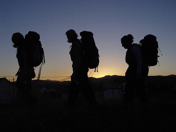 three hikers in camino de santiago - double_p stockfoto's en -beelden