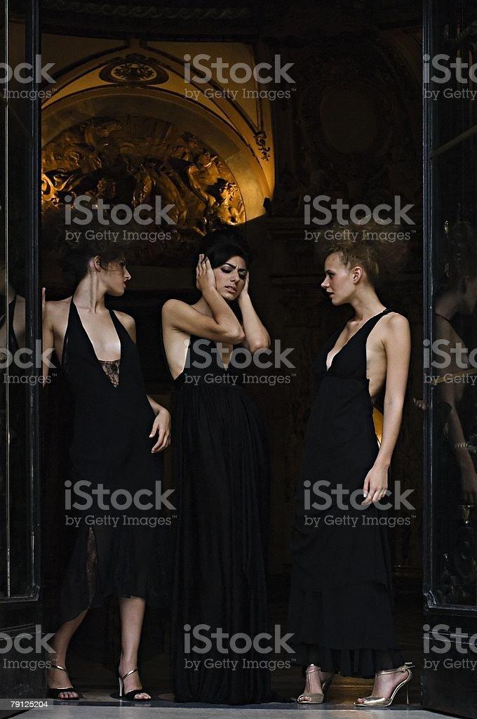 Three hispanic women standing in a doorway 免版稅 stock photo
